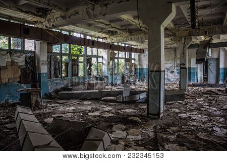 Abandoned Rotten And Overgrown Industrial Building In Sukhum, Abkhazia. Consequences Of War.