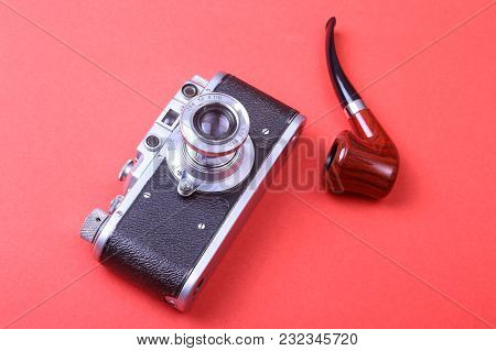 Old Retro Camera On Red Boards Abstract Backgroun