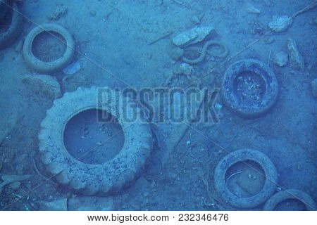 Sea pollution, old tires and other garbage underwater