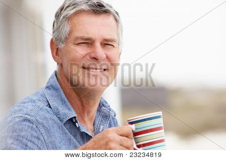Senior man relaxing outdoors