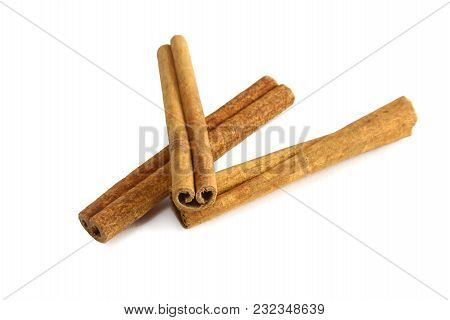 Top View Of Cinnamon Sticks Isolated On White