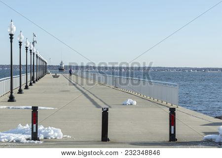 Man Walking Pier At Fort Taber Park