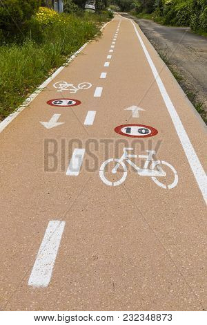 Bicycle Lanes With Roadsigns On The Asphalt. Sardinia Island, Italy