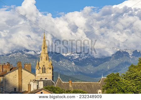 Tower Of Collegiate Church Of Saint-andre In Grenoble City, France. Sunset View. French Alps On The
