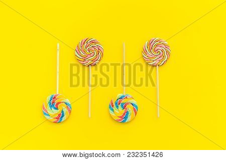 Sweets For Party Background. Lollipop On Yellow Top View Copy Space.