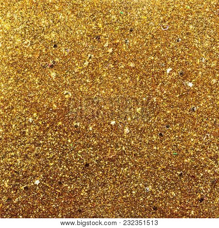 Beautiful Gold Glitter Background With Stars And Hearts Embedded Into The Glitter.