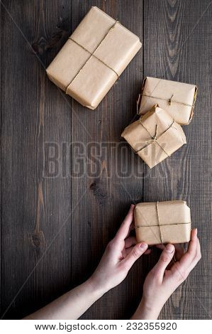 Parcels Box In Delivery Service Office On Wooden Background Top View Space For Text