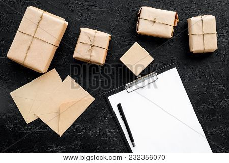 Parcels Box And Envelope In Delivery Service Office On Black Background Top View Space For Text