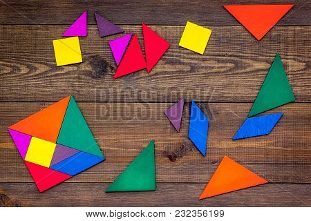 Color Paper Pieces For Business Puzzle On Wooden Table Background Top View Pattern