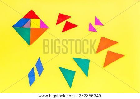 Business Solutions, Success And Strategy. Puzzle With Paper Pieces On Office Desk Yellow Background