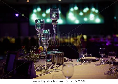 Beautiful White Chairs With Large Green Bows Stand At The Dinner Table