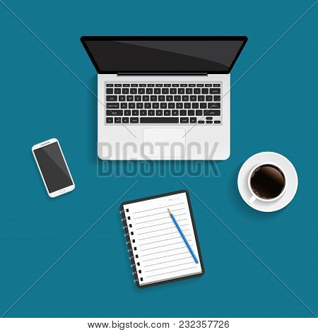 Laptop With Blank Screen, Smartphone, Cup Of Coffee And Office Stationery On The Wooden Table. Workp