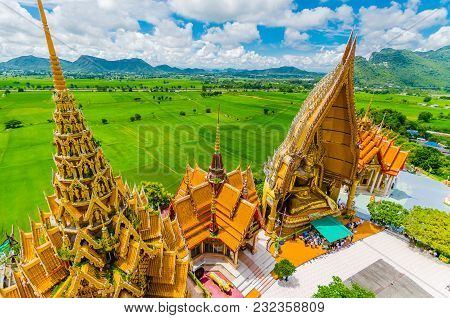 A View From The Top Of The Pagoda, Golden Buddha Statue With Rice Fields And Mountain, Tiger Cave Te
