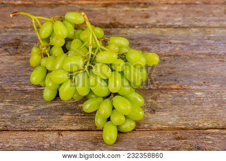White Grapes In An Old On Wooden Background.