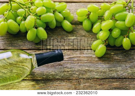 Wine Glasses And Grapes On Stone Table. With Space For Your Text White Grapes And Wine On A Wooden B