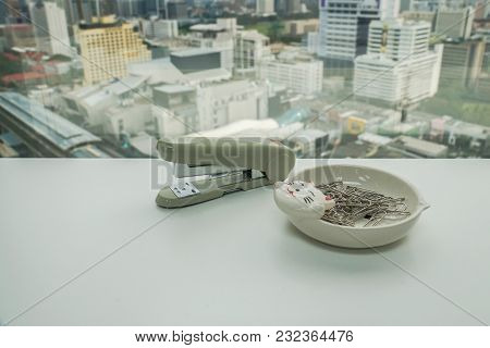 Office Stationary Stapler And Paper Clip On White Table For Business Documents