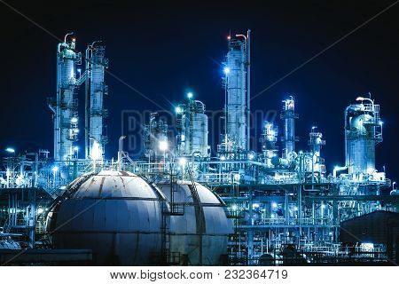 Gas Storage Sphere Tanks In Petrochemical Plant With Night, Glitter Lighting Of Manufacturing Plant