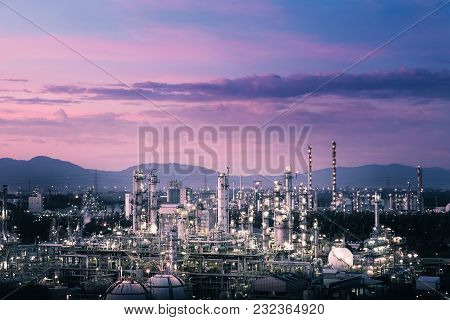 Glitter Lighting Of Petrochemical Plant With Sunset Sky Background, Estate Industry Of Fossil Petrol