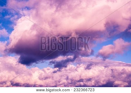 Pink cumulus clouds in the clear summer sky. poster