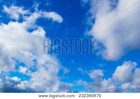 Blue cumulus clouds in the clear summer sky. poster