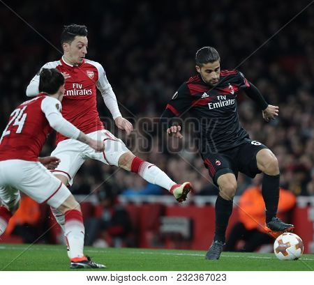 Hector Bellerin of Arsenal Mesut Ozil and Ricardo Rodrâ??guez of AC Milan during the Europa League match between Arsenal and AC Milan at The Emirates Stadium on March 15, 2018 in London, UK