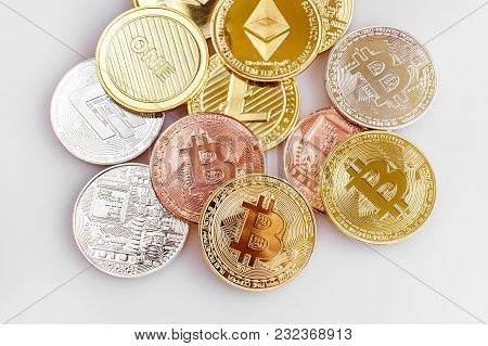 Physical Cryptocurrency, Bitcoin, Ethereum, Litecoin, Dash And A Random Pile Of Coins On White Backg