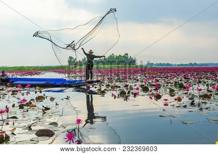 Udon Thani, Thailand - December 8, 2011, Fisherman On Blue Boat Fishing By Using Fishing Traditional