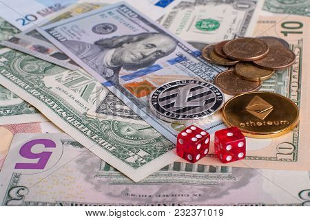 Crypto Currency Coins Ethereum And Litycoin Lying On The Euro And Dollar Banknotes With Red Dice. Co