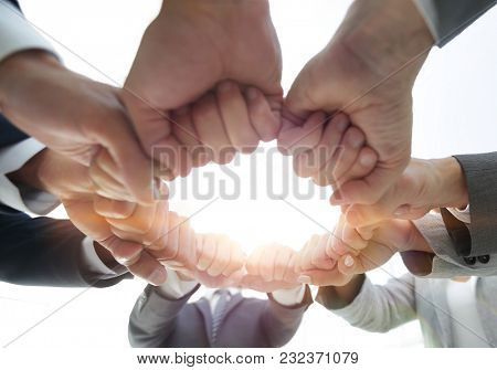 group of people joined their hands