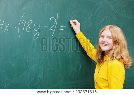 A Girl At The Blackboard In A Mathematics Class