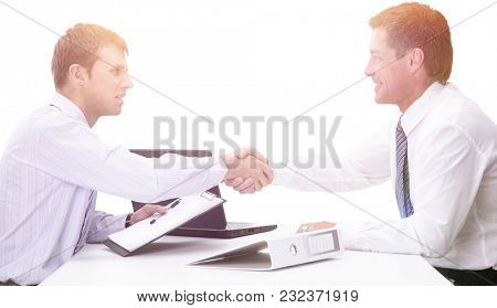 Two handsome men shaking hands with smile while sitting