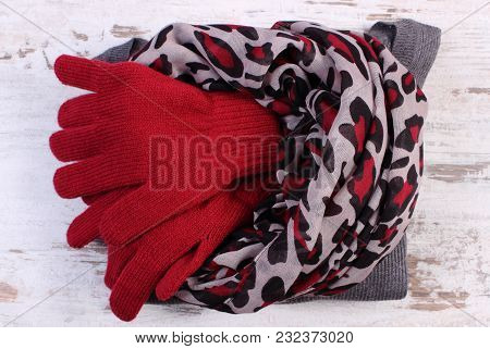 Woolen Clothes For Woman On Old Rustic Board, Womanly Accessories, Gloves Shawl Sweater, Warm Clothi