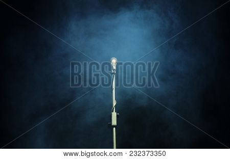 Microphone in a smoke on a dark background
