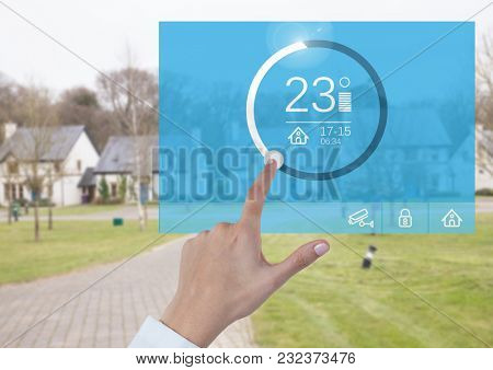 Digital composite of Hand touching a Home automation system temperature App Interface