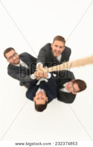 smiling business team holding the rope