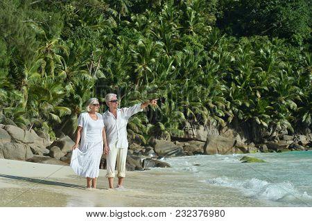 Beautiful Happy Elderly Couple Resting At Tropical Resort