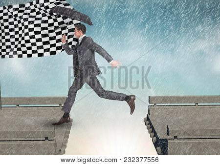 Digital composite of businessman with umbrella arriving to the checker flag in a broken bridge