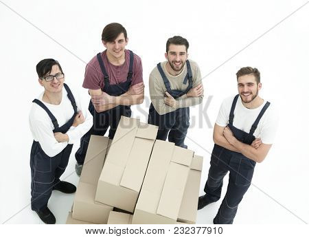Young movers holding boxes isolated on white background,