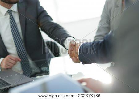 confident handshake of business partners