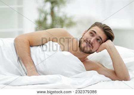 closeup.a man dreams of lying on the bed
