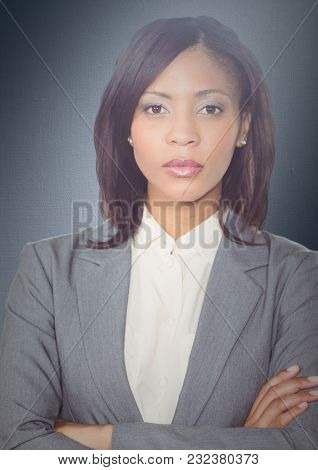 Digital composite of Close up of business woman arms folded against navy background