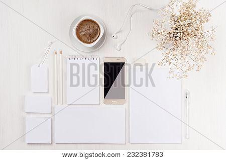 Modern Minimalistic Elegant Wominihe Work Space With White Blank Stationery, Coffee, Dried White Flo