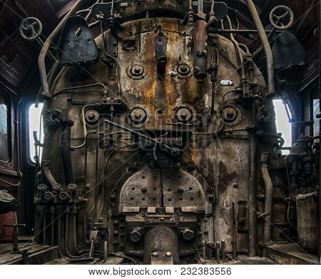 Cabin Of An Old Diesel Locomotive With An Oven.