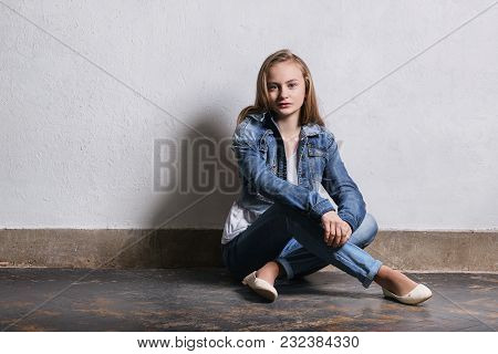 Girl Near White Wall. Fashion Hipster Teen Sits Floor.girl Blonde Adolescent 11 Years.young Caucasia