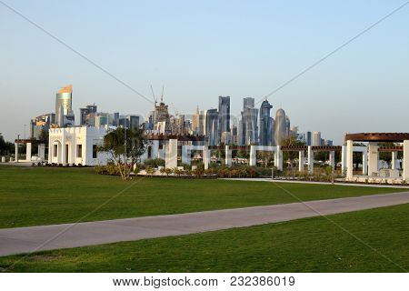 BIDDA PARK, Doha, Qatar - March 21, 2018: View of buildings in the newly opened Bidda Park in the centre of Qatar's capital, with Doha's skyline beyond.