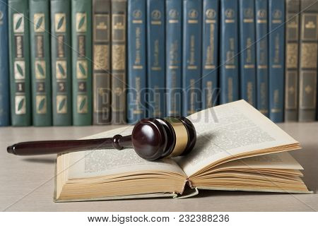 Law Concept. Books With Wooden Judge's Gavel On Table In A Courtroom Or Enforcement Office.