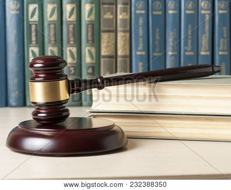 Law Concept. Wooden Judge Gavel And Books On Table In A Courtroom Or Enforcement Office