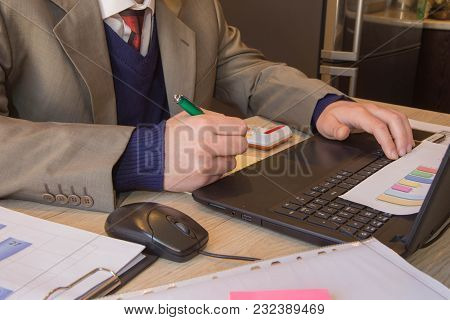 Corporate Businessman Working At Office Desk, He Is Using A Calculator. Man Doing His Accounting, Fi