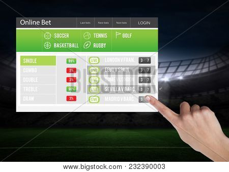Digital composite of Hand touching a Betting App Interface stadium