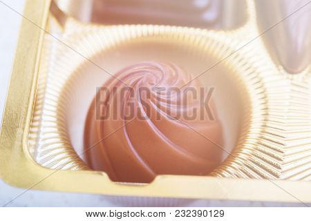 A Collection Of Mixed Chocolates Against Isolated On A White Background